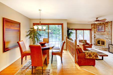 open floor plan: House with open floor plan. View of dining area with table set and brick fireplace in the living room.