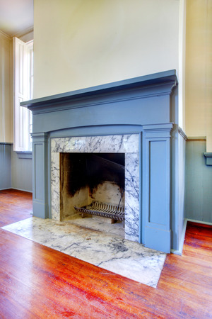Antique fireplace with blue mental and white marble from 1856. Lakewood, WA. USA