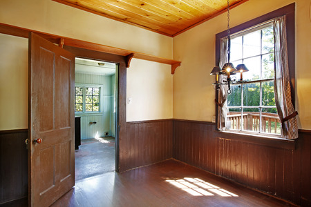 unfurnished: Antique kitchen room interior with wood ceiling and siding wall trim. Stock Photo