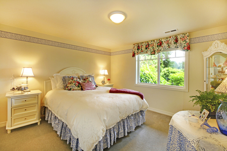 furnished: Elegant bedroom interior with white bedding and beige walls.  Furnished with comfortable bed and nightstand.