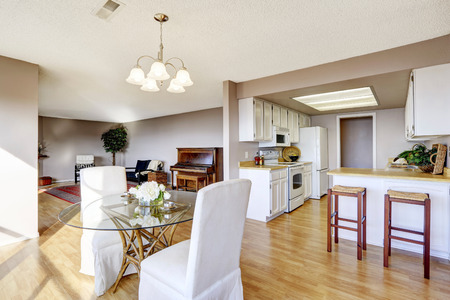 designer chair: Dining area connected to kitchen and living room with hardwood floor Stock Photo