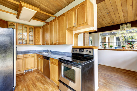 kitchen counter top: Kitchen  with hardwood floor and granite counter top connected to dining area