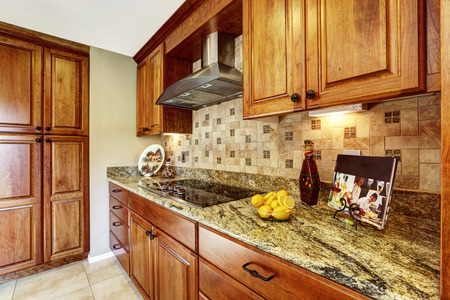 granite: Luxury kitchen with tile floor, stained cabinets and granite counter top
