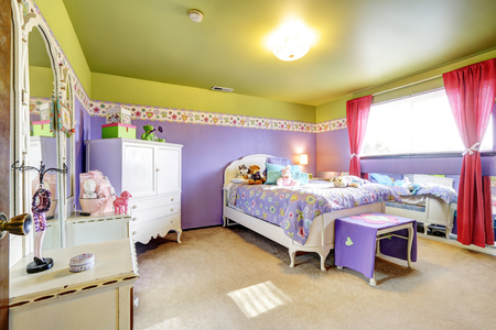 bedroom furniture: Girls children purple and green bedroom with mirror and white furniture