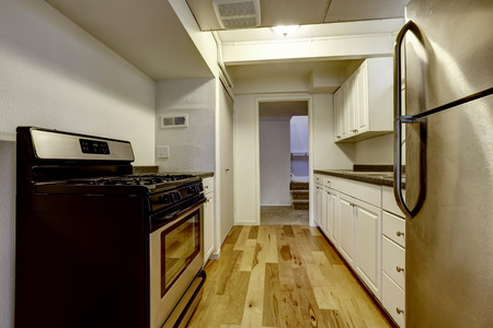 stainless steal: White old kitchen with stainless steal appliances and hardwood floor