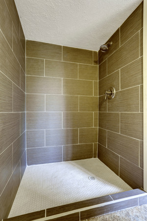 bathroom tile: Brown stone tile shower with close up in the bathroom Stock Photo