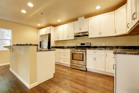 furnished: Kitchen room with white appliances, kitchen island and hardwood floor