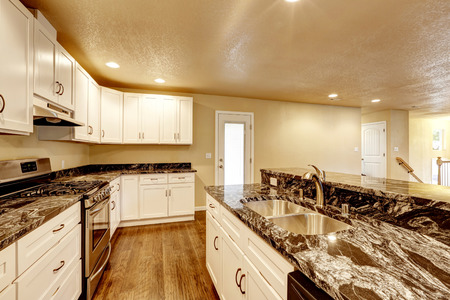 kitchen island: Kitchen room with white appliances, granite counter top, kitchen island and hardwood floor