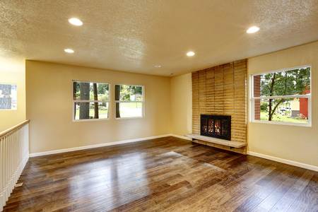 fireplace living room: Large empty living room with fireplace and hardwood floor.