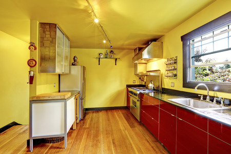 yellow walls: Kitchen room interior with yellow walls and red cabinets. Countryside house