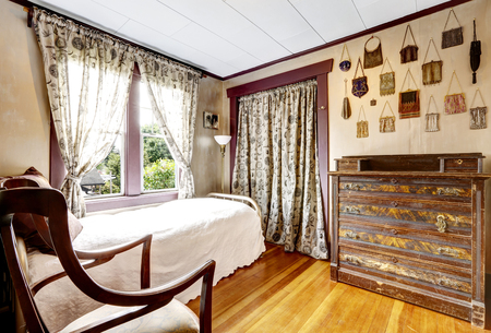old furniture: Small bedroom with hardwood floor and old sharpen furniture. Countryside house