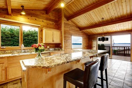 open floor plan: Wooden trim home with open floor plan. Kitchen with granite counter top. Water view Editorial