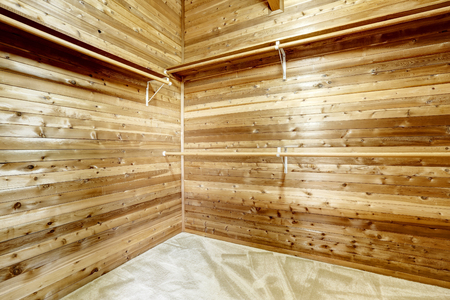 checkroom: Wide empty wooden dressing room, interior of a countryside house Stock Photo