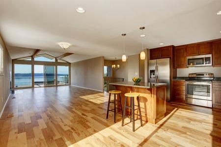 hardwood floor: Spacious kitchen interior with hardwood floor and beige walls in luxury house. Stock Photo