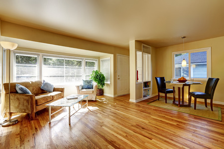 engeneering: Open dining room with hardwood floor connected to dining room with teo black leather chairs