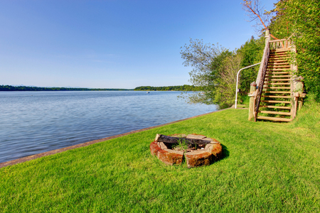 fire pit: Backyard area with wonderful water view, fire pit and well kept lawn around.