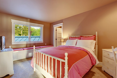 furnished: Adorable girls room with pink walls, white furniture set and red bedding.
