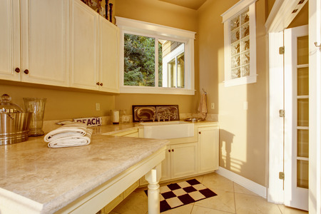 kitchen counter top: Bright kitchen room area with white cabinets, granite counter top and tile floor