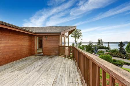 american house: American house with wooden walkout deck overlooking backyard and ocean