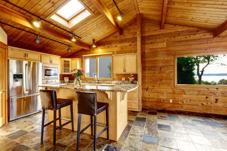 open floor plan: Wooden trim home with open floor plan. Kitchen with granite counter top. Water view Stock Photo