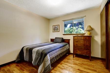 bedroom furniture: Simple american bedroom with hardwood floor and wooden furniture