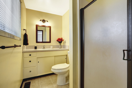 bathroom tile: Beige tone bathroom interior with tile floor