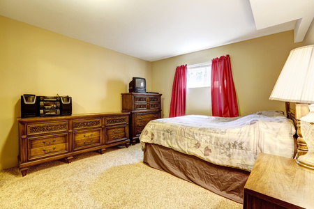 bedroom furniture: Bedroom with vintage furniture and carpet floor