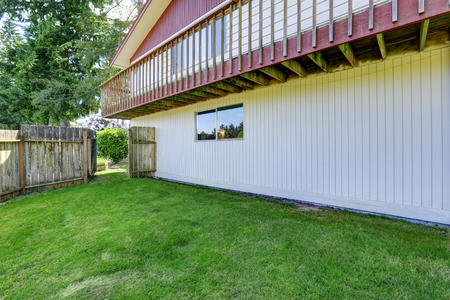 lawn area: Spacious backyard area with wooden fence and green lawn