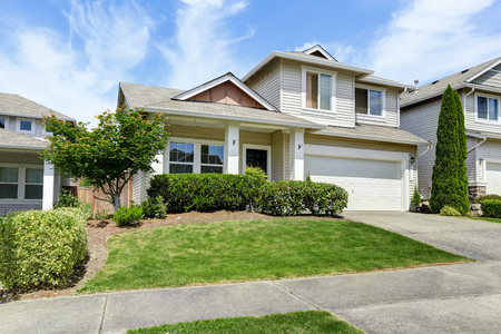 curb: House exterior with curb appeal. View of entrance porch, garage and driveway.