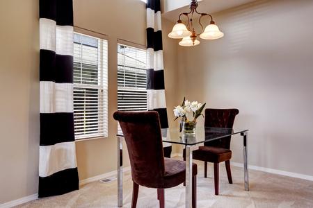open floor plan: Open floor plan dining room with carpet floor and glass table Stock Photo