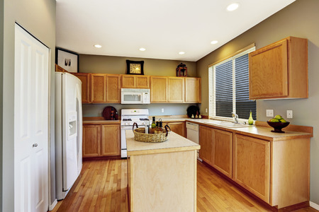 kitchen cabinets: Kitchen interior with brown cabinets, hardwood floor and island