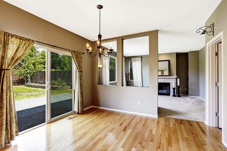 hardwood floor: Hallway with hardwood floor connected to living room. View to backyard