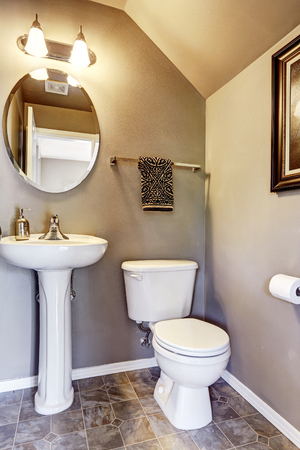 bathroom tile: Small bathroom interior with tile floor and small mirror