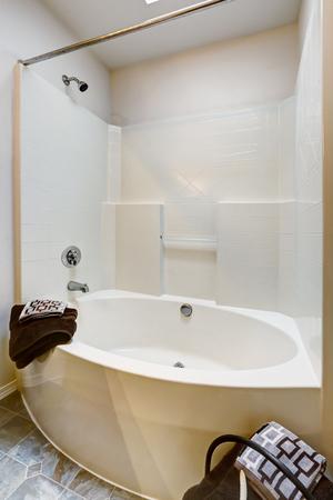bathroom tile: New bathroom with tile floor and white bathtub.