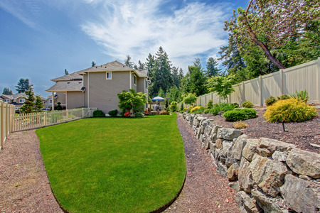 Big house with backyard patio and landscape design Stock Photo
