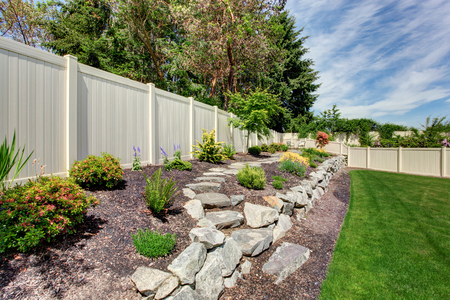 fenced: Big house with fenced backyard patio and landscape design