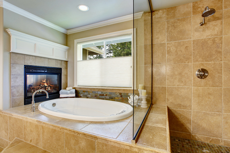 whithe: Classic American bathroom with whithe bath tub and shower. Also fireplace
