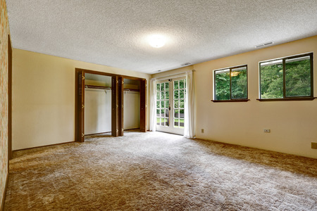 walk in closet: Large empty room with soft carpet floor and opened walk in closet