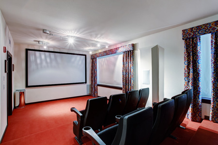 without window: Home TV movie theater entertainment room interior with real cinema chairs.