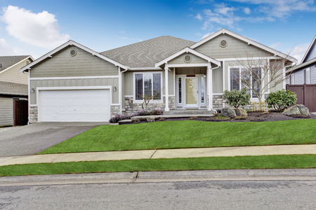 curb appeal: House exterior. View of entrance porch with walkway and garage with driveway Stock Photo