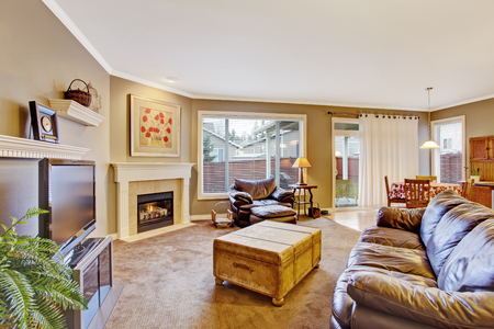 fireplace living room: Classic brown and white living room interior with fireplace
