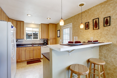 granite kitchen: Small kitchen area with granite tops and white appliances Stock Photo