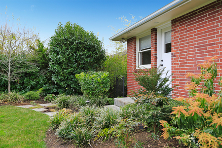 fenced: Fenced backyard. View of green lawn and flower beds Stock Photo