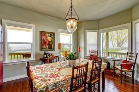 tablecloth: Classic American dining area connected to kitchen. Old wooden table set with nice tablecloth