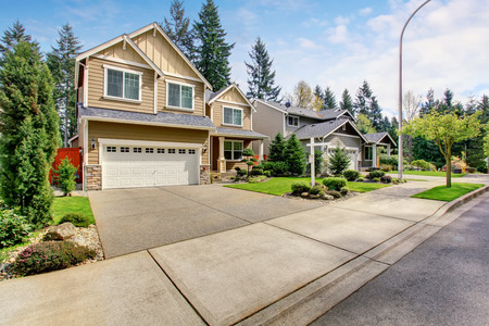 two story: Nice curb appeal of American two story house with perfect landscape design. View of Garage with Driveway