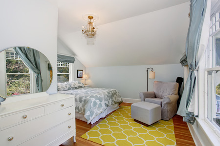 vaulted ceiling: Small blue and yellow upstairs bedroom with vaulted ceiling and hardwood floor.