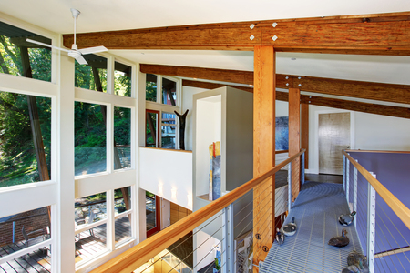 wooden beams: Staircase bridge with panoramic view and wooden beams ceiling. Open floor plan.