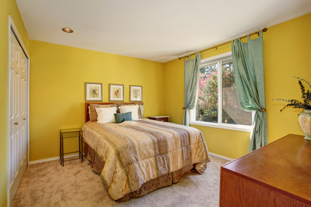 Stock Photo   Yellow And Green Bedroom Interior With Small Bed And Beige  Carpet Floor.