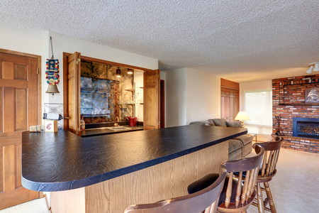 Spacious Open-plan Living Room With A Bar Counter, Wooden Stools ...