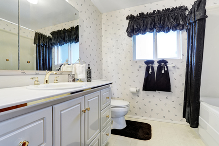 blue curtain: Elegant white bathroom with dark blue curtain, tile floor and cabinets